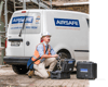 Airsafe employee in front of an Airsafe van